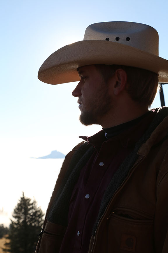 young man with cowboy hat